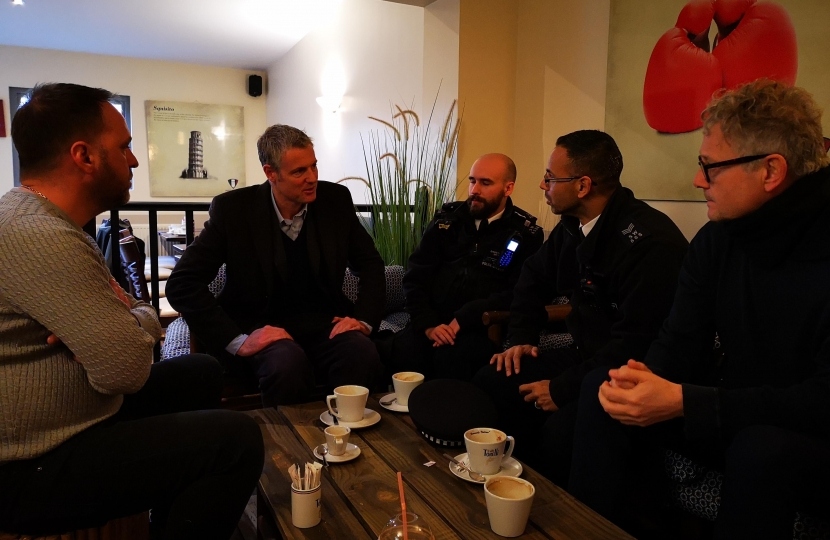 Zac Goldsmith MP discusses stabbing and crime on Kew Parade with local police officers at Torelli's Cafe in Kew